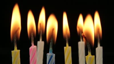 stock-footage-birthday-cake-candles-on-black-background