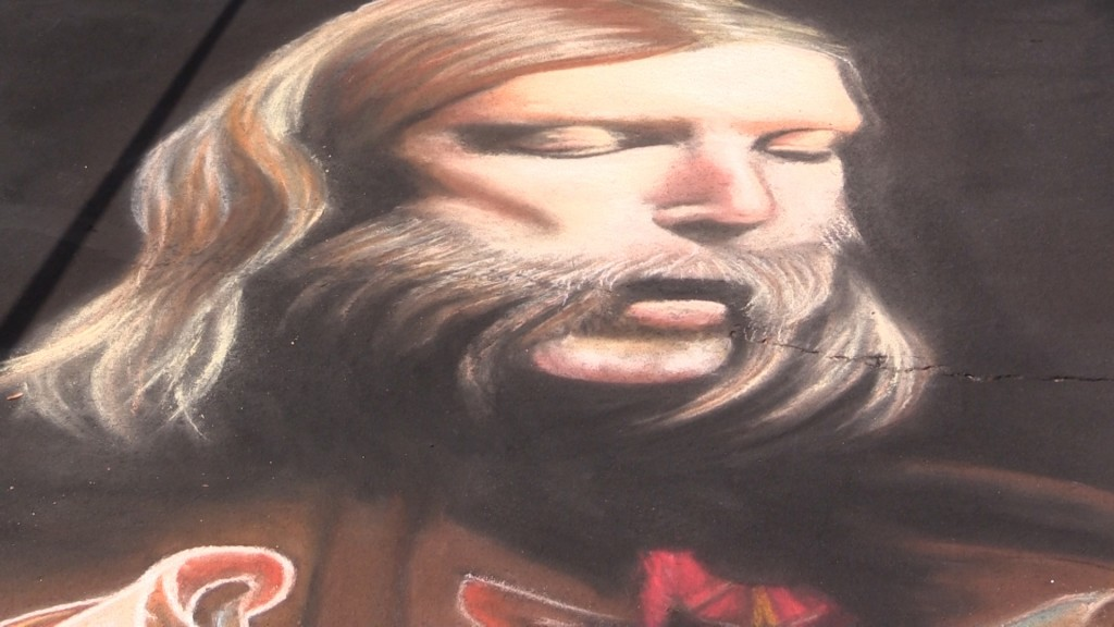 Andrew Patrick Henry joins multiple artists to draw elaborate chalk art throughout Macon.