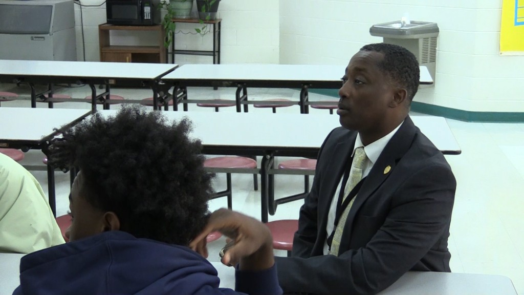 Chief Tim Chatman of the Dublin Police Department teachers his Transformers program to teens at Moore Street School Tuesday.