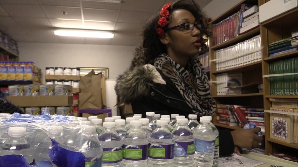 Teen raises cases of water for Flint