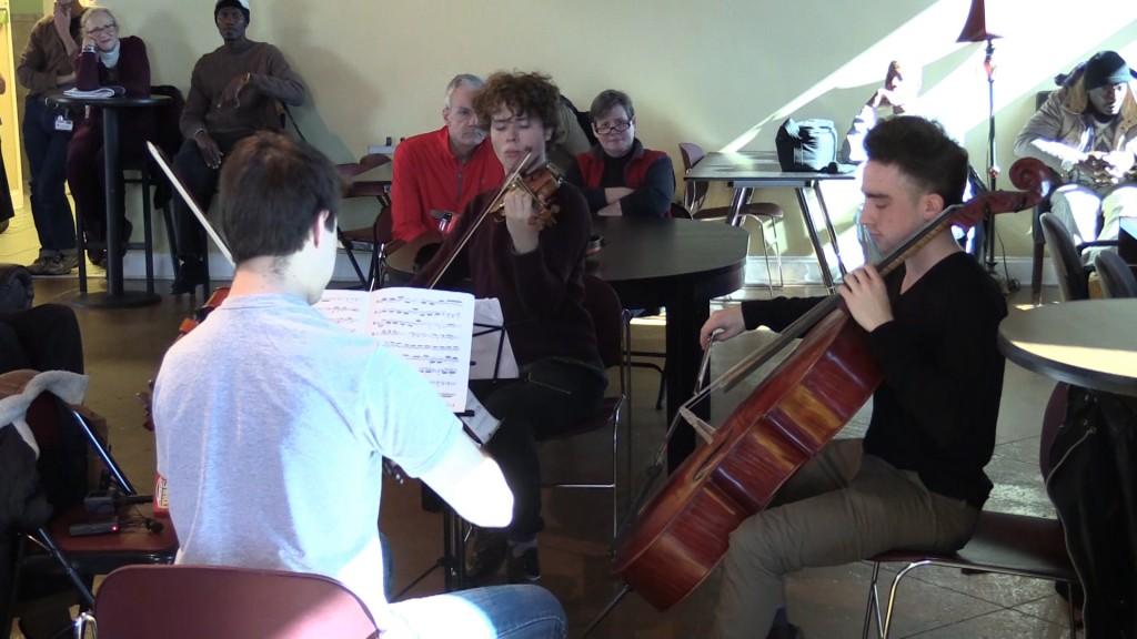 Mercer String Trio plays for homeless at Daybreak.