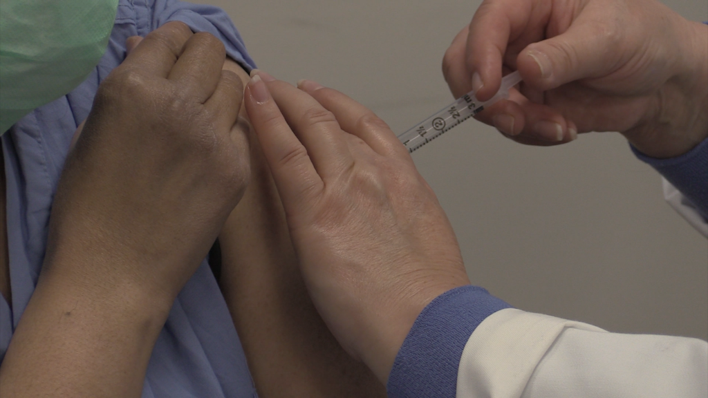 The Moderna Vaccine is administered to the NCHD.