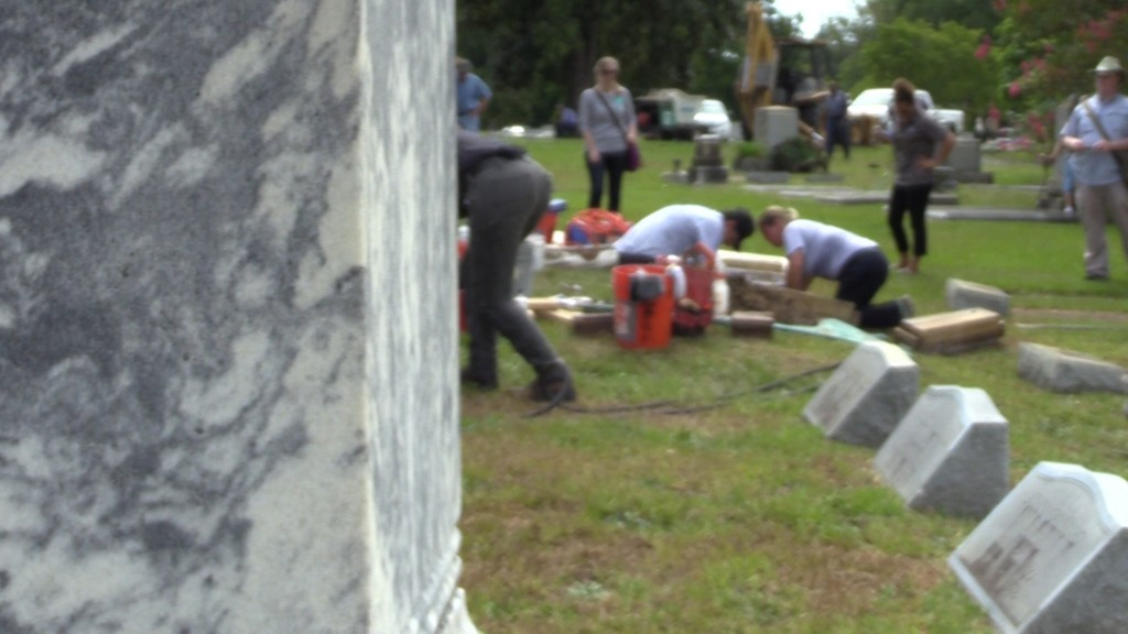 Conservationists working to maintain a headstone at Riverside Cemetery in Macon.