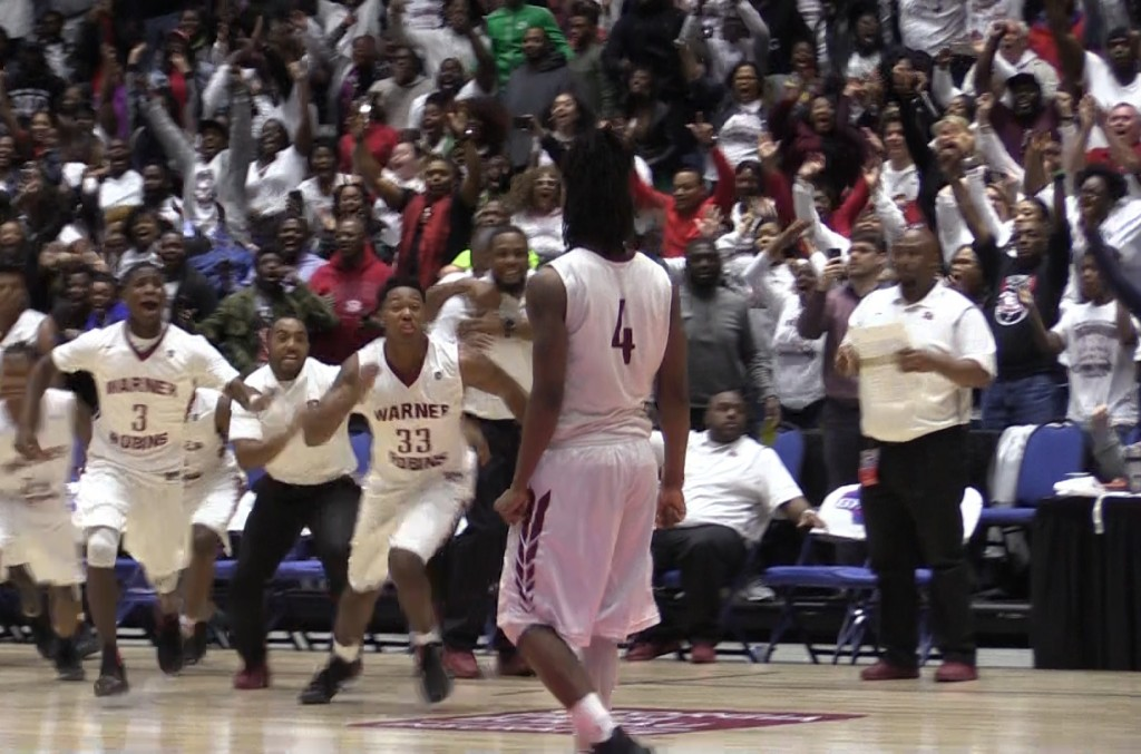 Warner Robins celebrates after Jacolbey Owens' go-ahead three pointer with 1.3 seconds remaining in the GHSA AAAAA title game Thursday at the Macon Centreplex.
