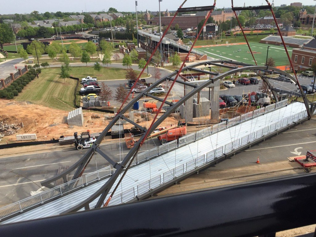 A bridge connecting The Lofts at Mercer to campus was lifted into place Wednesday morning.