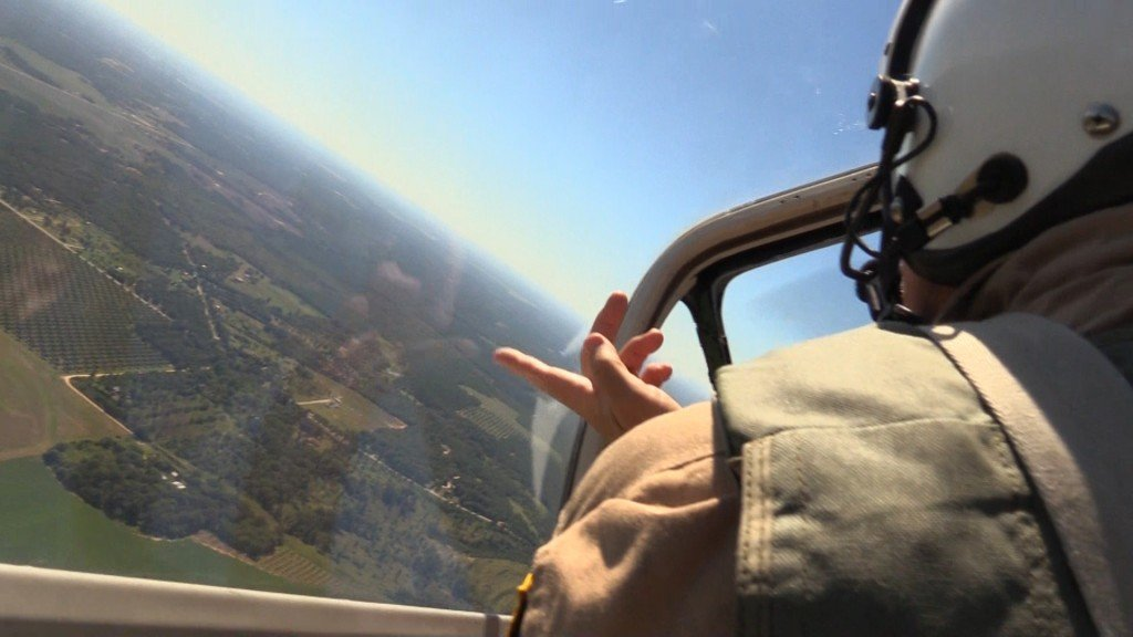 Stan Musick flying over Perry.