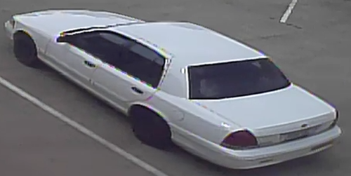 White Ford Crown Victoria used in an armed robbery.