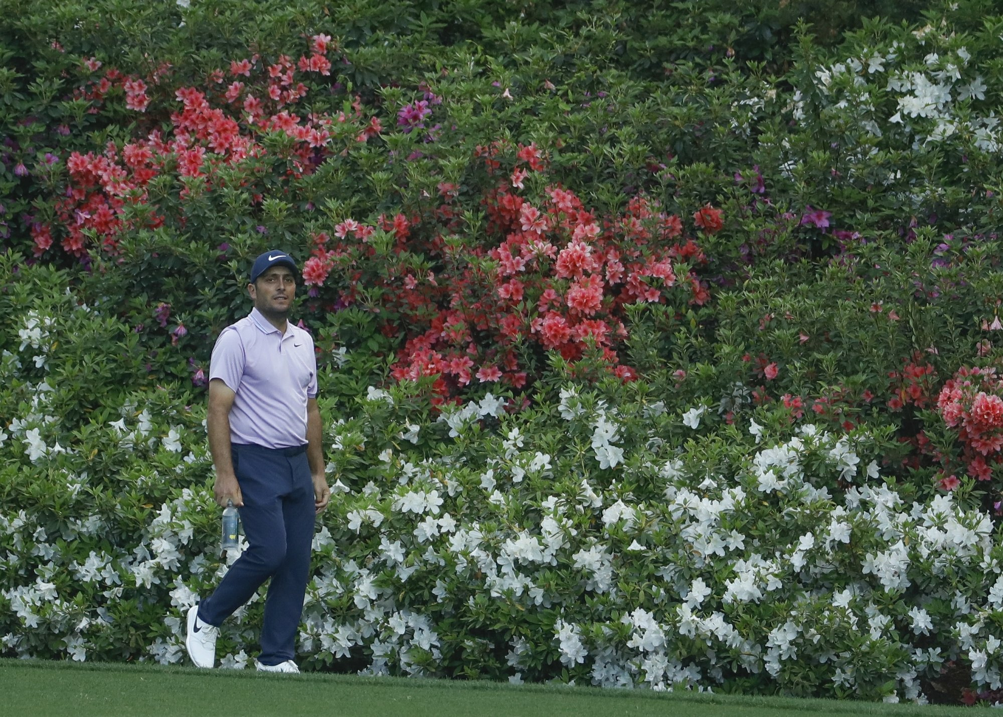 molinari leads by two  woods in final group before masters