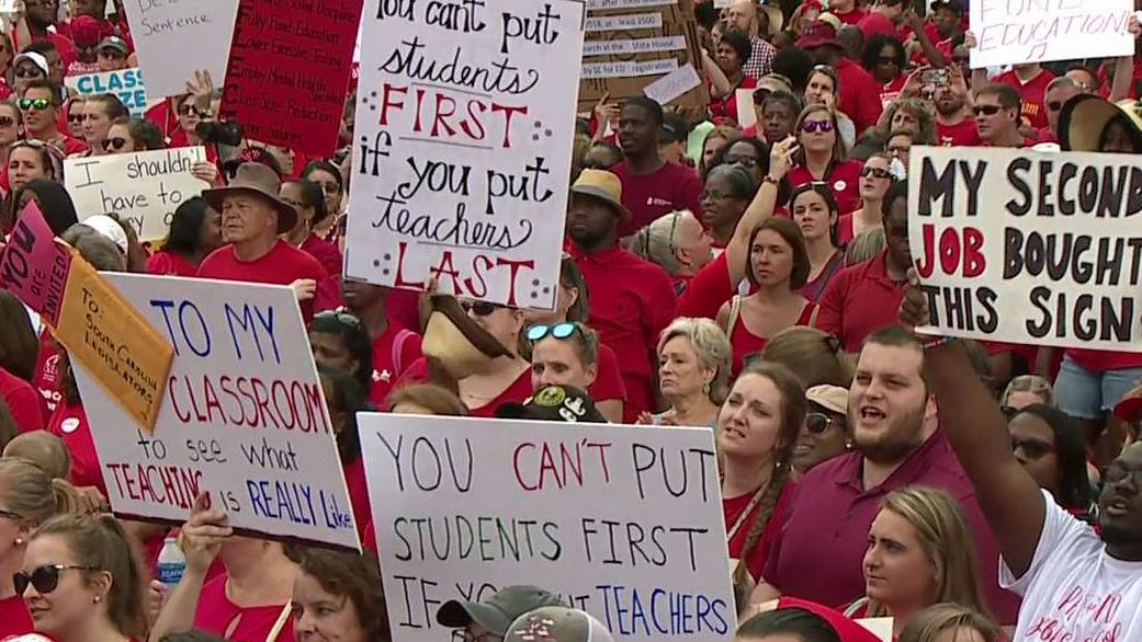 Thousands of teachers rally at the state house for change
