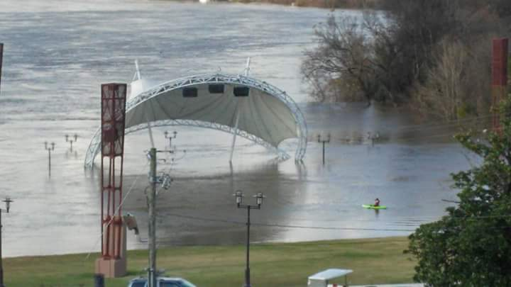 A photo of the flooded Riverwalk Amphitheatre in Montgomery.
