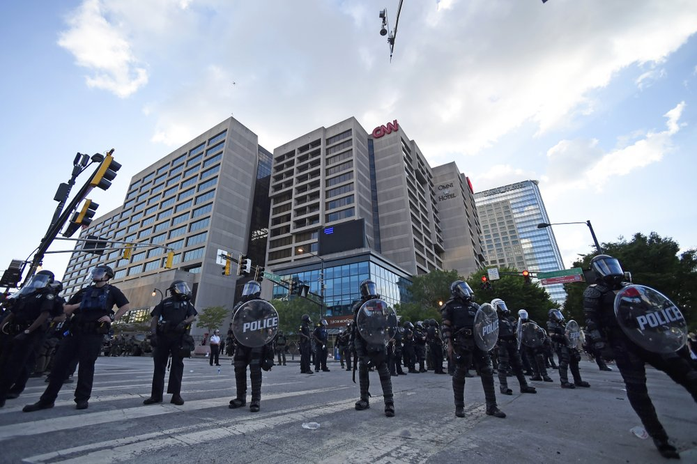 Atlanta Police, monitor demonstrators protesting, Saturday, May 30, 2020 in Atlanta. The protest started peacefully earlier in the day before demonstrators clashed with police. (AP Photo/Mike Stewart)