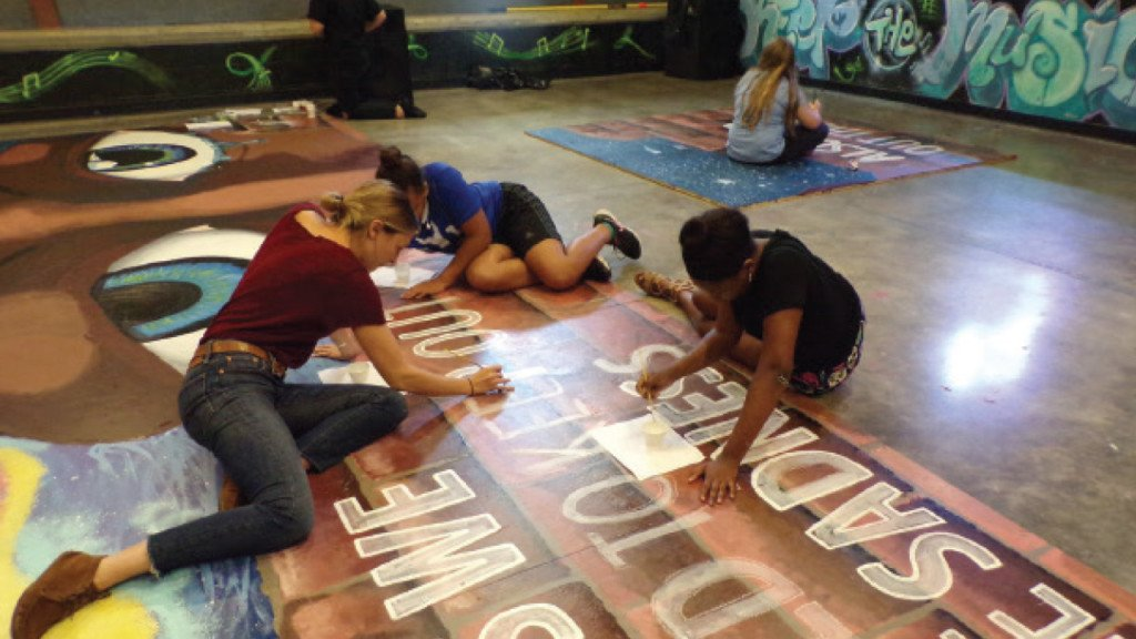Summer program students worked on this mural painting at the Goodman Community Center