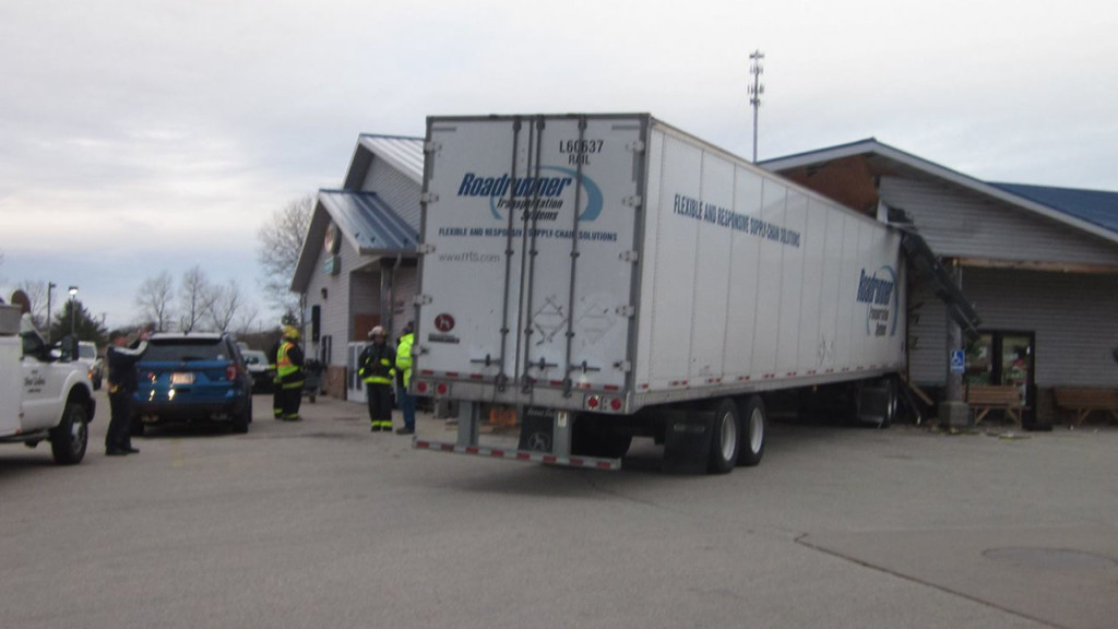 Semi drives into travel mart in New Lisbon