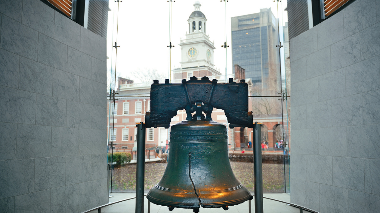 liberty bell with independence hall in the background