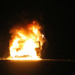 Ambulance with flames visible while driving becomes fully engulfed, officials say