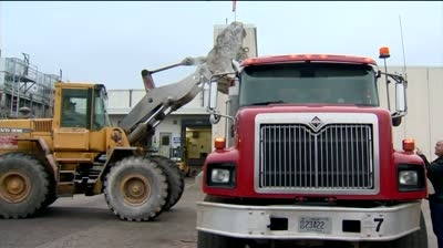 Portage packaging plant employees clean up after fire