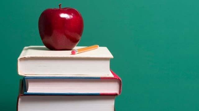 School supplies and an apple