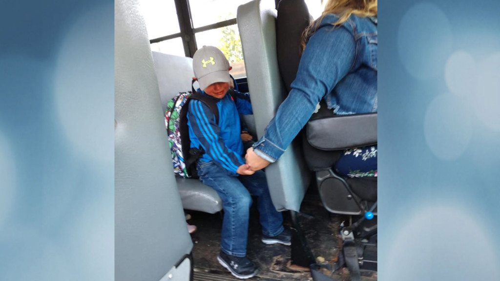 Photo of Wisconsin bus driver holding boy's hand on first day goes viral