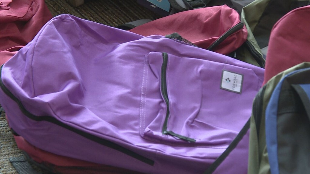 100 Black Men of Madison gives free backpacks and school supplies to families in need