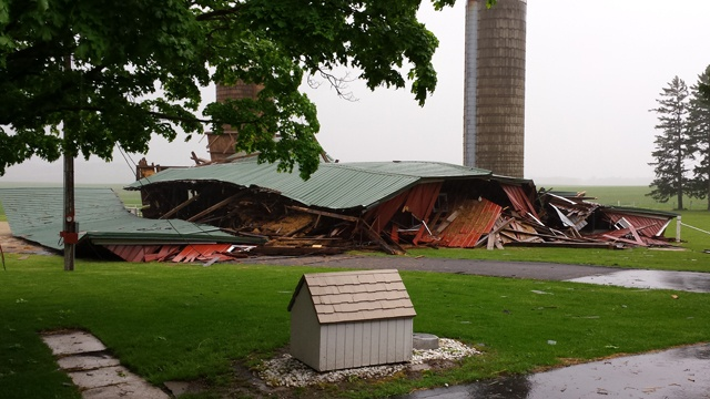 Barn, large trees taken down by storms