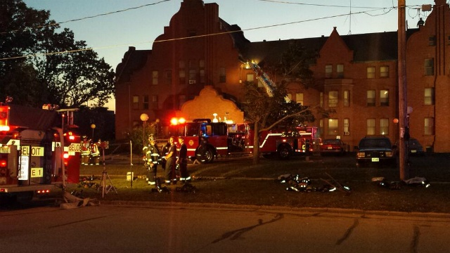 Fire in 4-story apartment building out, officials say