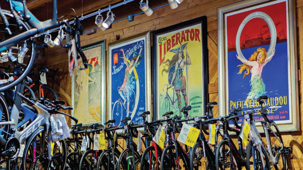 Machinery Row Bicycles' line of vintage posters with bicycles all around
