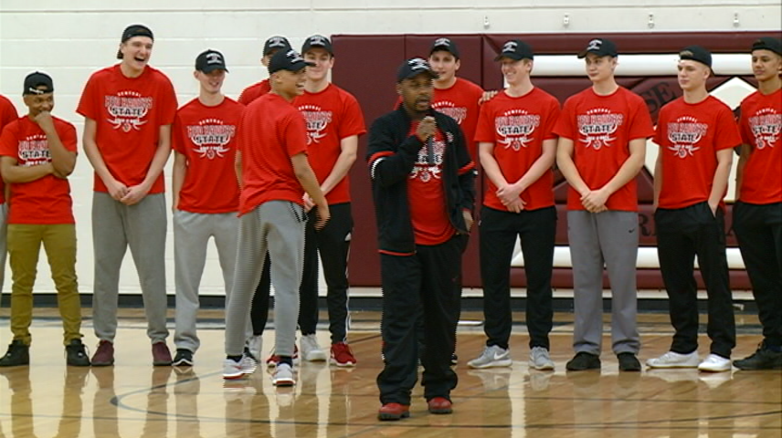 The Central High School boys' basketball team gives back to player from other team