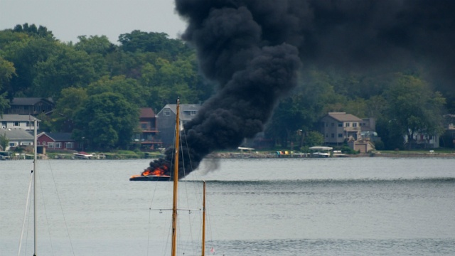 Four people safe after fire breaks out on boat