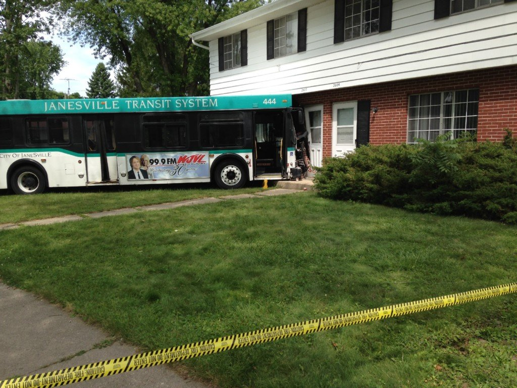 Three people injured after bus crashes into house