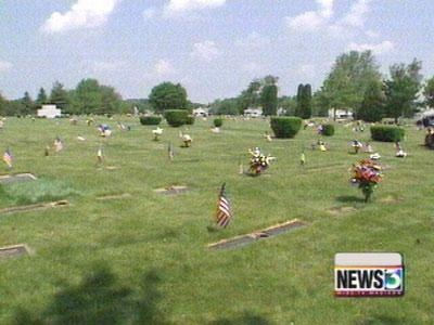Police look for gold Cadillac seen in cemetery during theft