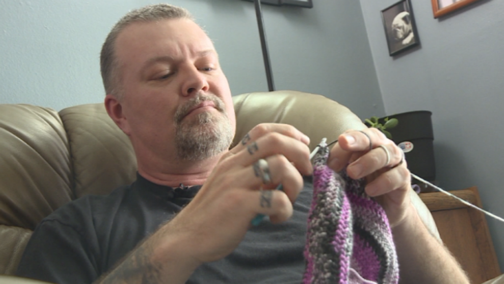 Man crochets hats for cancer patients, says past drug abuse, prison led him to pay it forward
