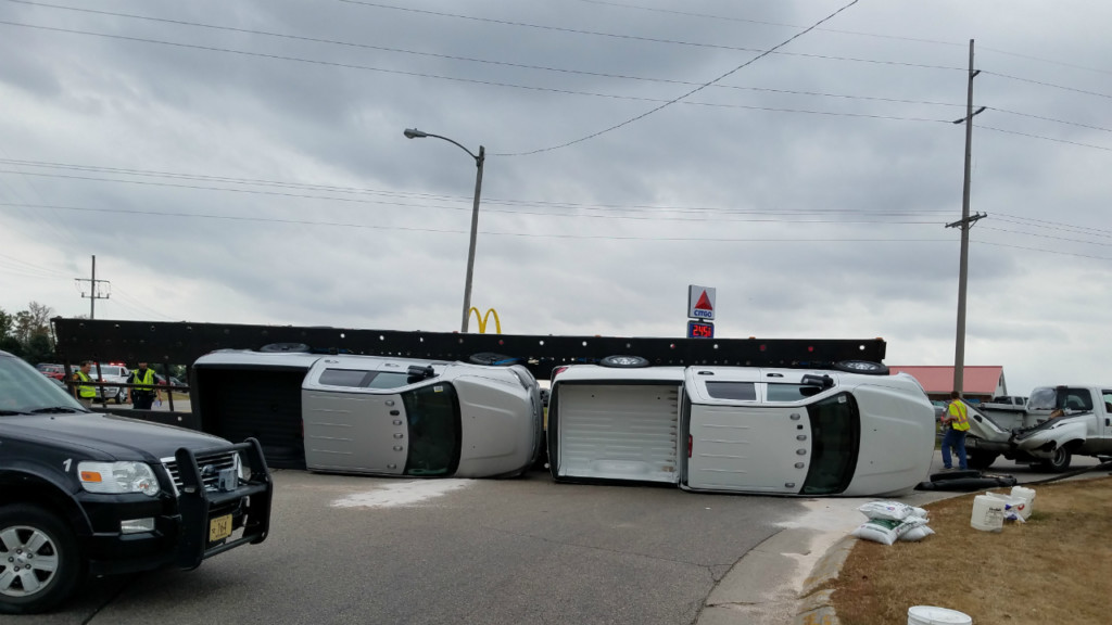 Trucks worth more than $120K damaged in rollover crash, police say