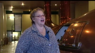 Brewery founder sits near first lady during speech