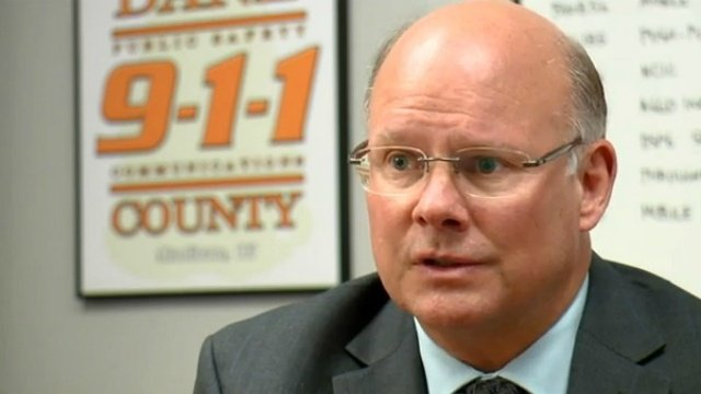 County board approves new 5-year deal for 911 director