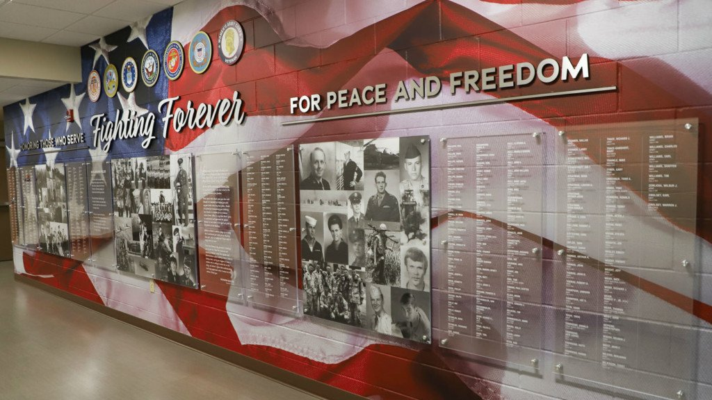 Dodgeville High School honors veterans through tribute wall featuring names of alumni