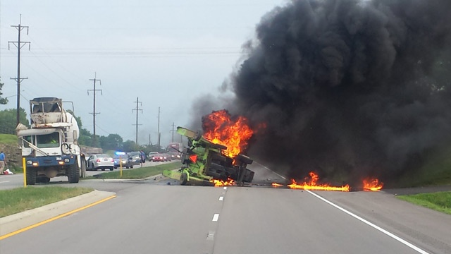 Vacationing police officers help at fiery crash