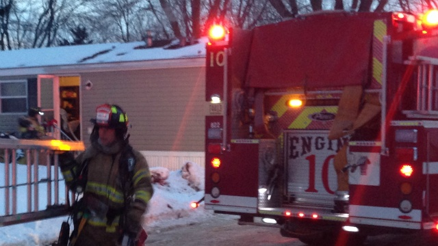 Adult, child transported for smoke inhalation in kitchen fire
