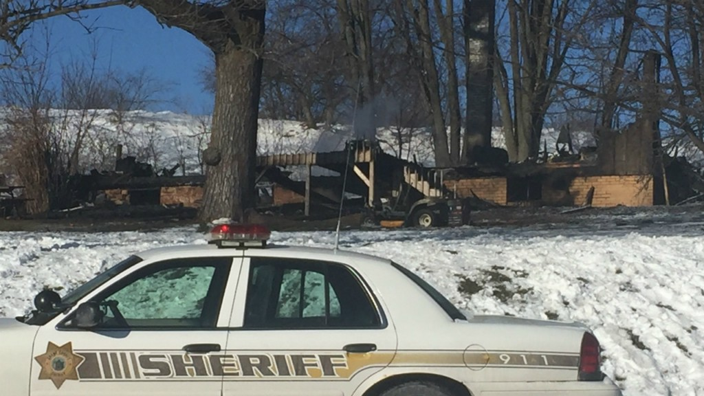 Officials ID man pulled from fatal house fire by son