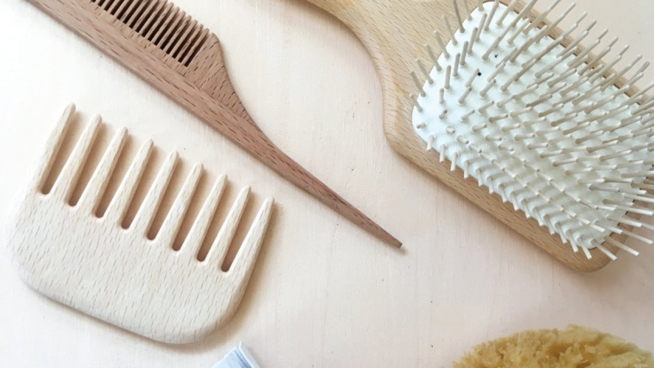 bamboo combs and brushes laid out on a table