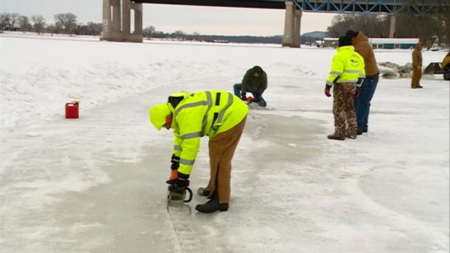 Crews cut ice for Polar Plunge in La Crosse