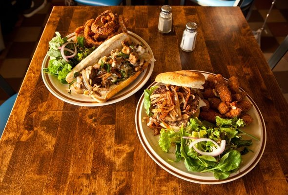 The Seitan Philly sandwich (left) pairs nicely with onion rings. The D. Williams Burger goes great with a side of cheddar cheese curds.