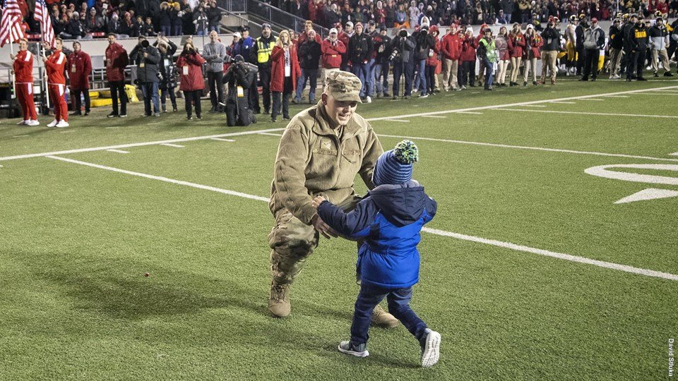 Air Force member surprises family with early reunion at Badger football game