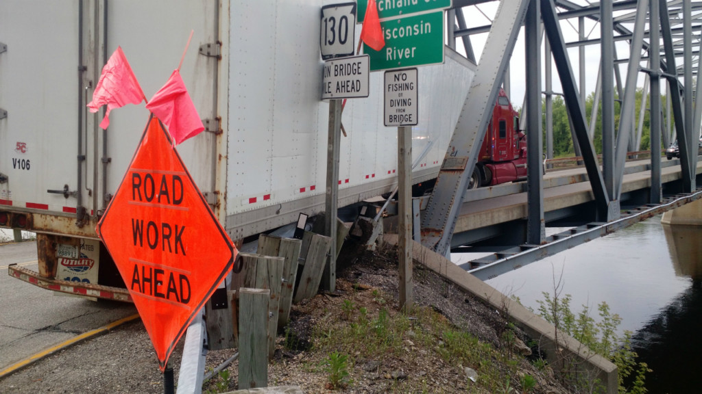Semi stuck on bridge guardrail closes Iowa County highway, officials say