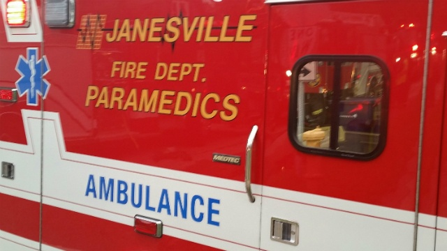 Crews on scene after car drives into train in Janesville