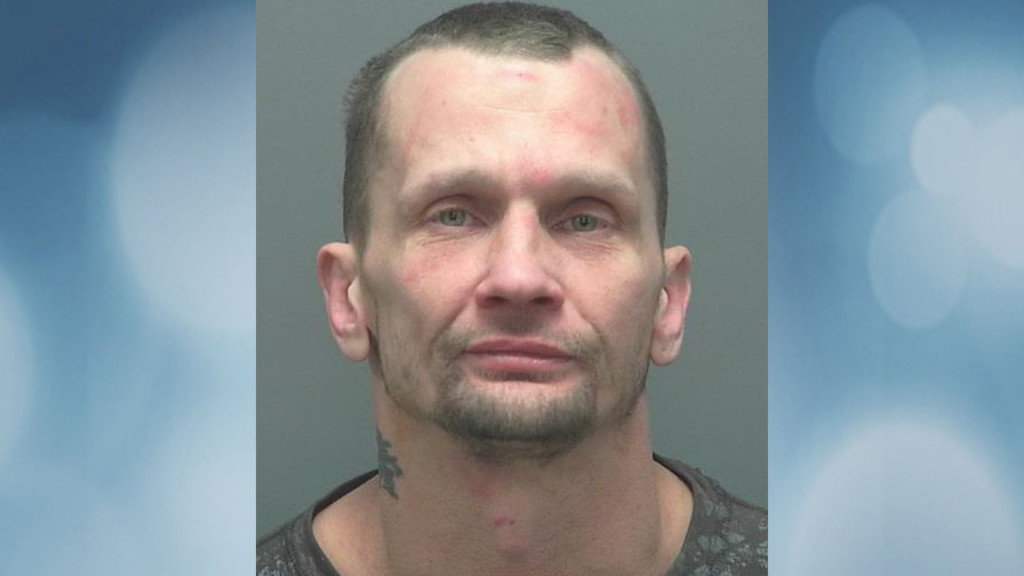 Man spits at, threatens officers while being arrested, police say