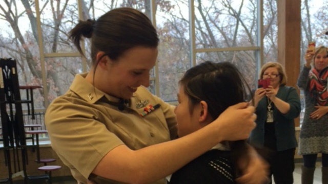 Vet surprises sister with homecoming at middle school