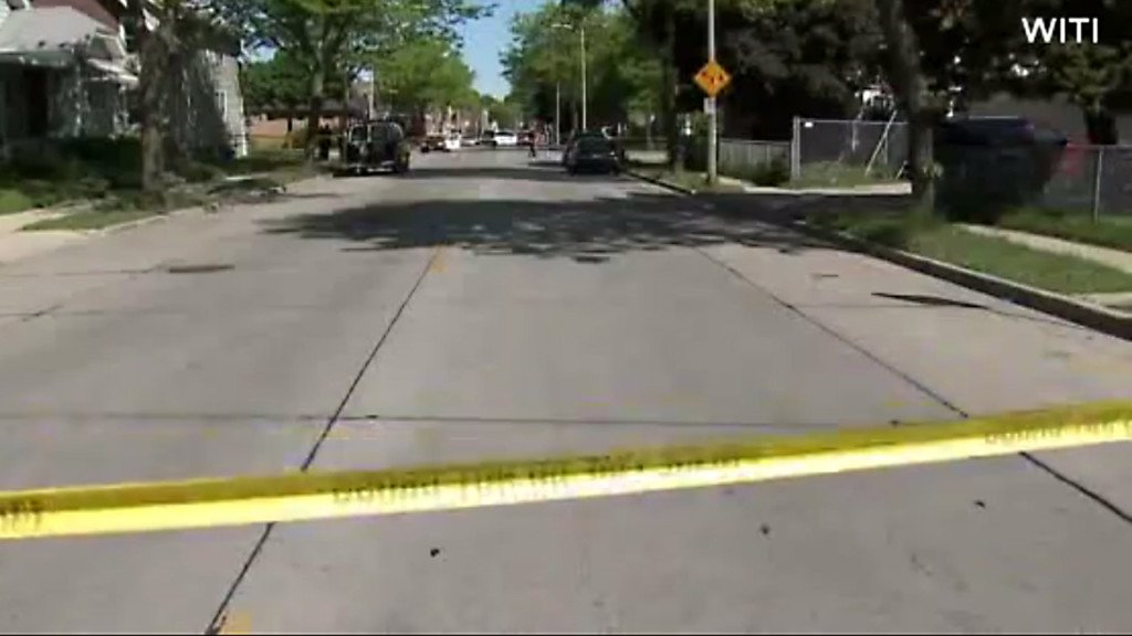 Driver dies after being shot, crashing into Milwaukee house