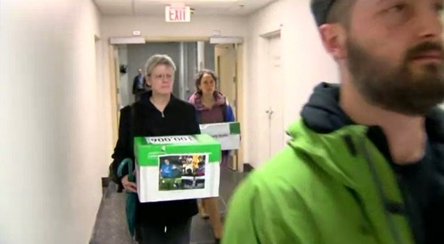 Group delivers 100,000 signatures for officer's dismissal