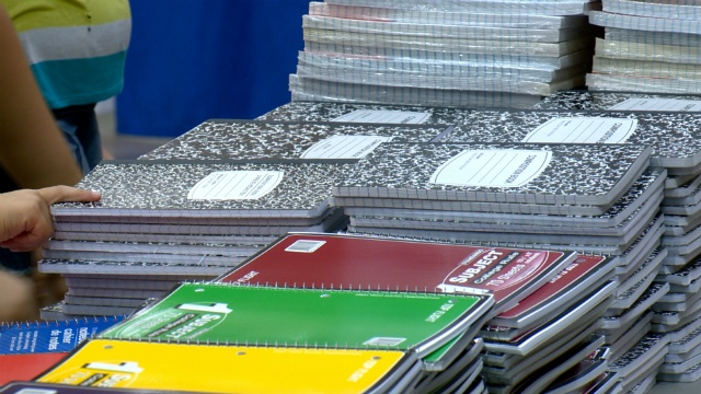 Firefighters, construction company donate school supplies