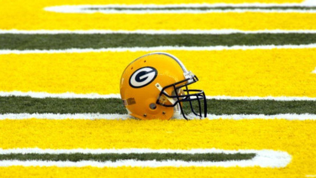 Packers helmet on field